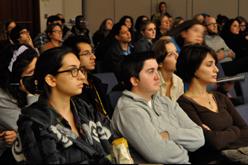 Audience members listen to a Q&A following a free screening.